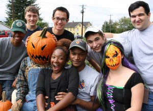 Volunteers stop to pose with their Pumpkin Faced Friends!