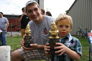 Watermelon Eating contest Winners Keegan and Duke pose with their cool trophies!