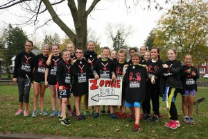 Runners display their shirts announcing whether they survived or fell victim to the Zombies.